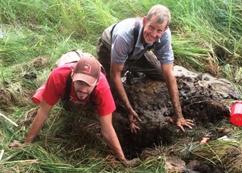 Lon and Tyson digging a soil pit at a MN site